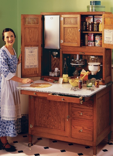 Hoosier Cabinet retro image with lady posed infront of antique hoosier cabinet