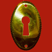 Oval Stamped Brass Keyhole Cover Vertical B-0256